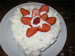 Valentine cake with cream and strawberries
